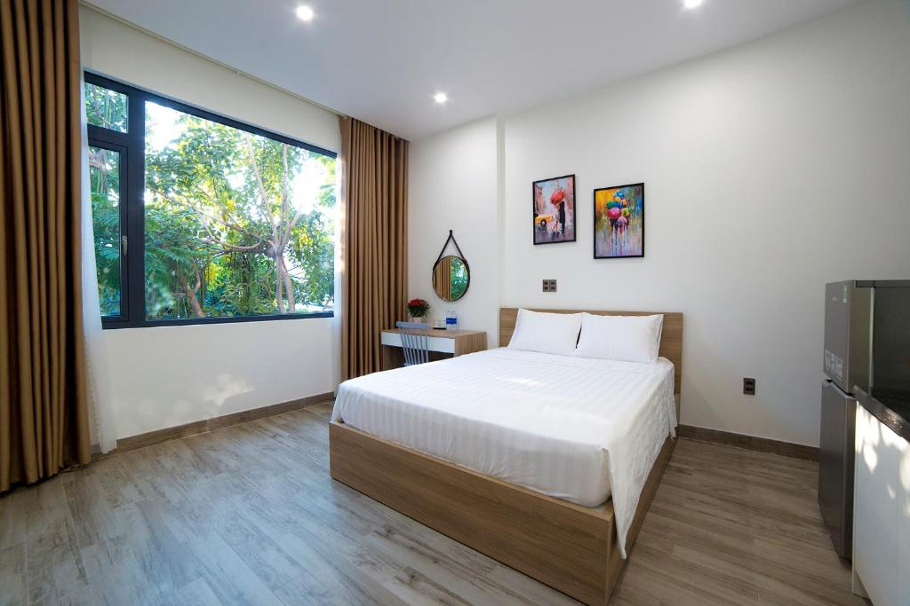 A bed or beds in a room at Gilda Hostel Apartment