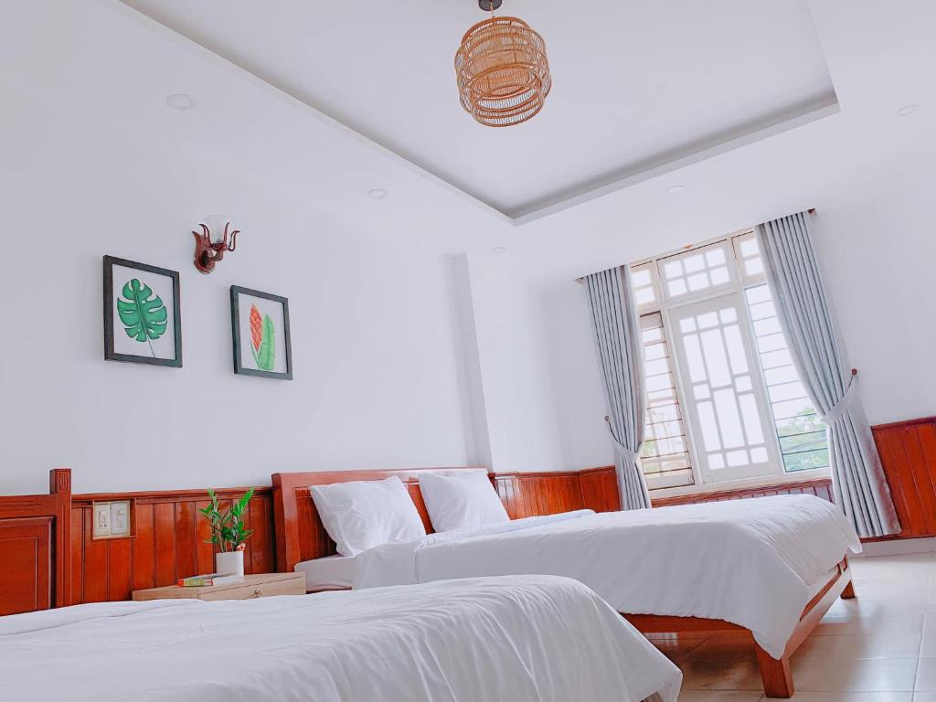 A bed or beds in a room at VIỆT Hostel
