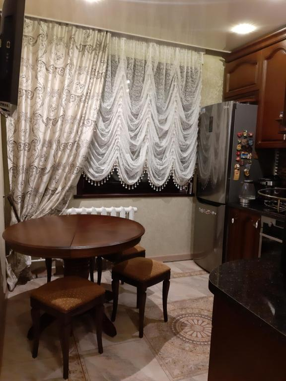 Гостиная зона в Apartment on Aviatorov 91