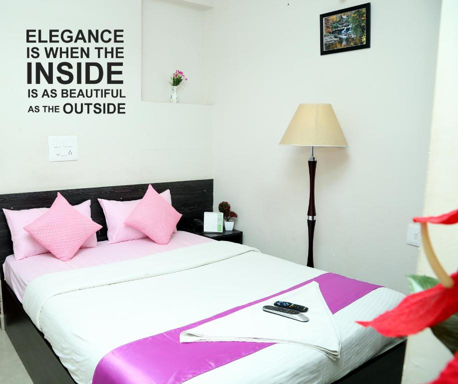 A bed or beds in a room at Orange Corner Kempegowda International Airport