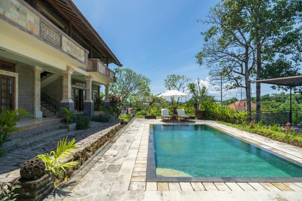 The swimming pool at or near OYO 675 Balakosa Resort Bali