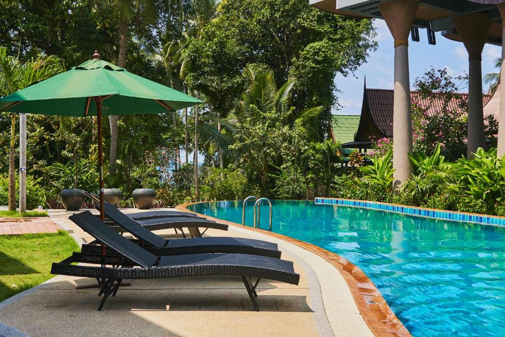 The swimming pool at or close to Seaflower Bungalows