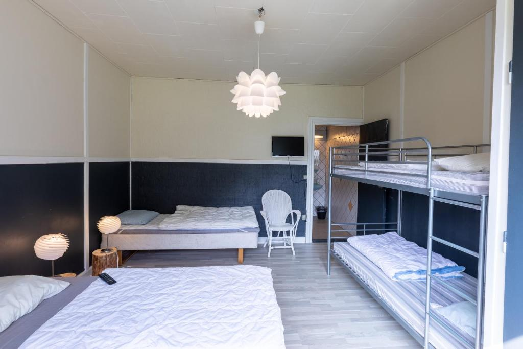 A bunk bed or bunk beds in a room at Velling Koller Hostel