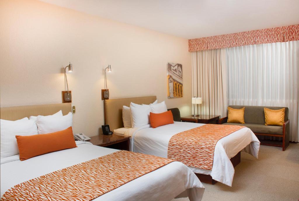 Ein Bett oder Betten in einem Zimmer der Unterkunft Boutique Hotel Jade