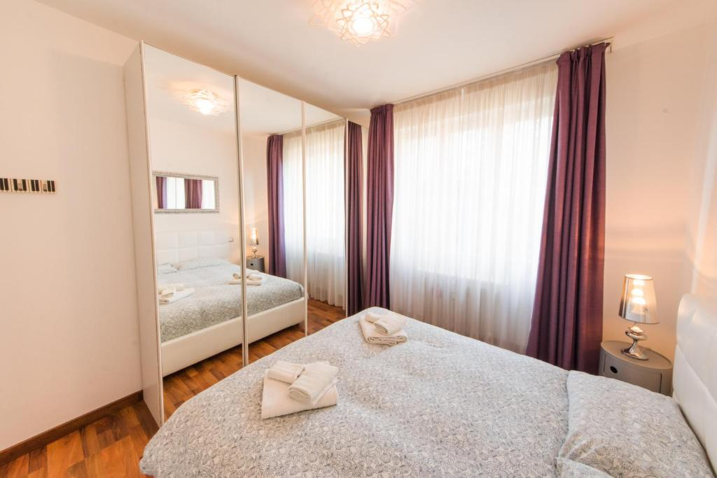 Letto o letti in una camera di Zenzero & Cannella Boutique Rooms