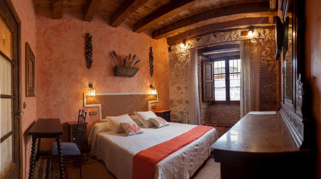 Cama o camas de una habitación en Hotel Rural La Enhorcadora
