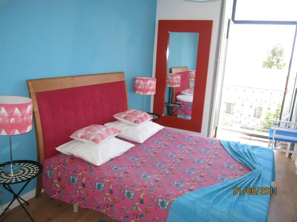 A bed or beds in a room at B.Mar Hostel & Suites