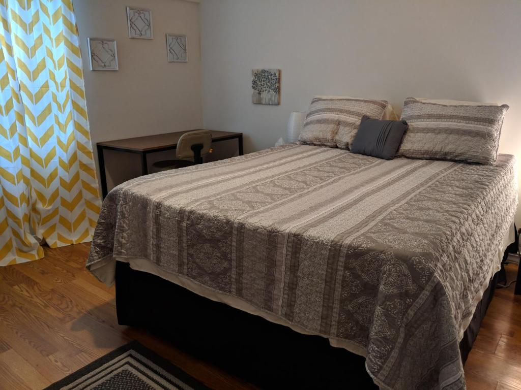 A bed or beds in a room at Treme Two Bedroom Suite
