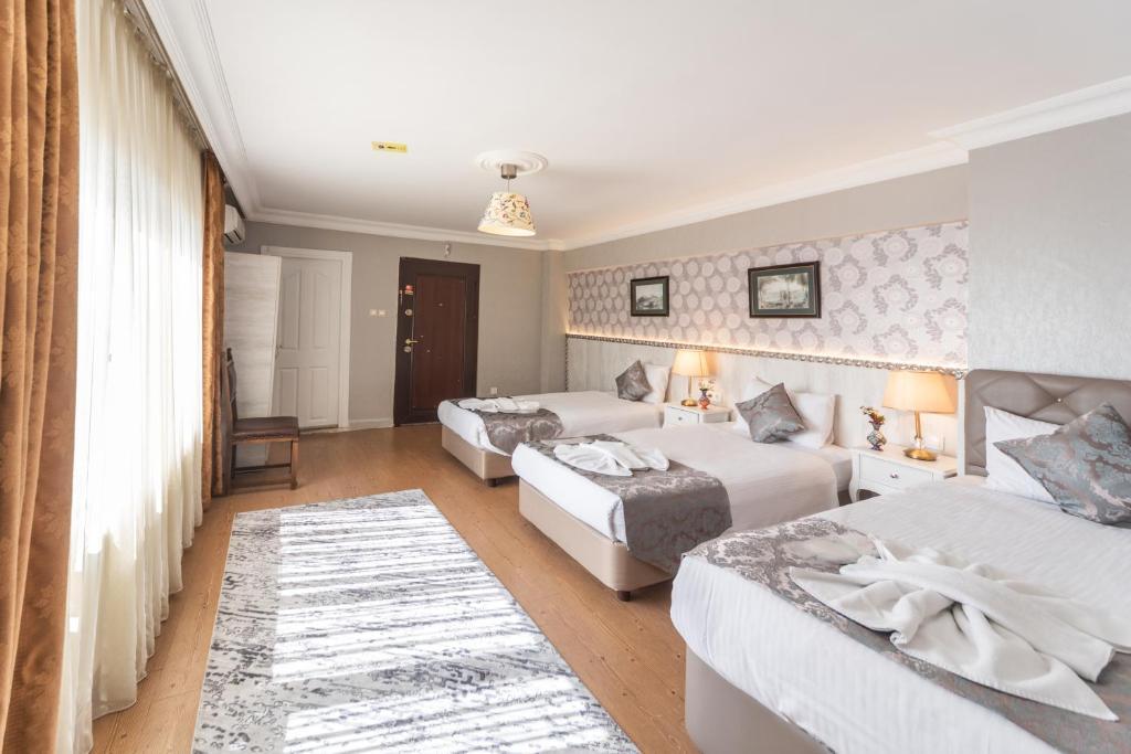 Кровать или кровати в номере Sultan House