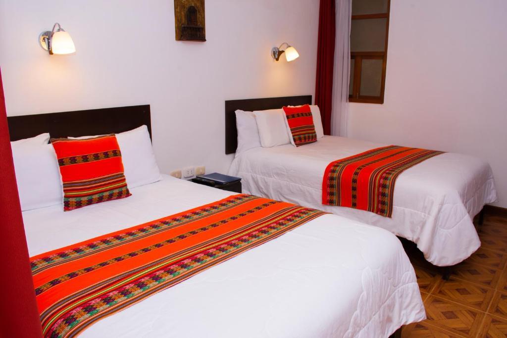 Cama o camas de una habitación en La Casa de Los Balcones