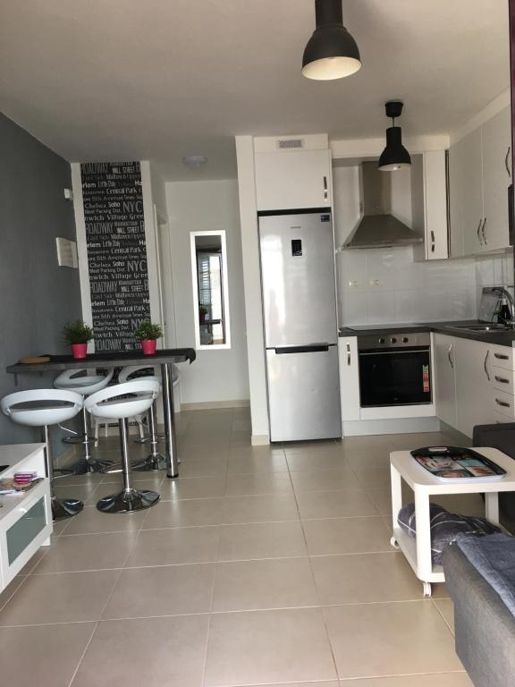 A kitchen or kitchenette at Sun Beach Bungalows