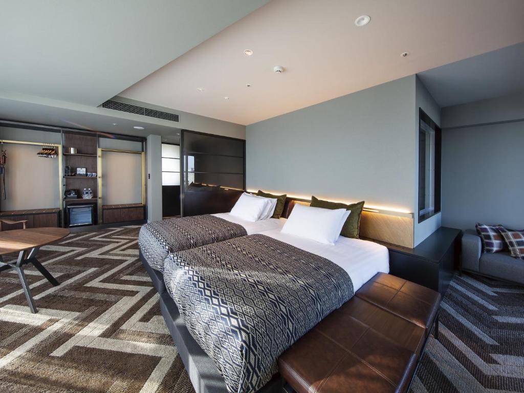 Giường trong phòng chung tại Shibuya Stream Excel Hotel Tokyu