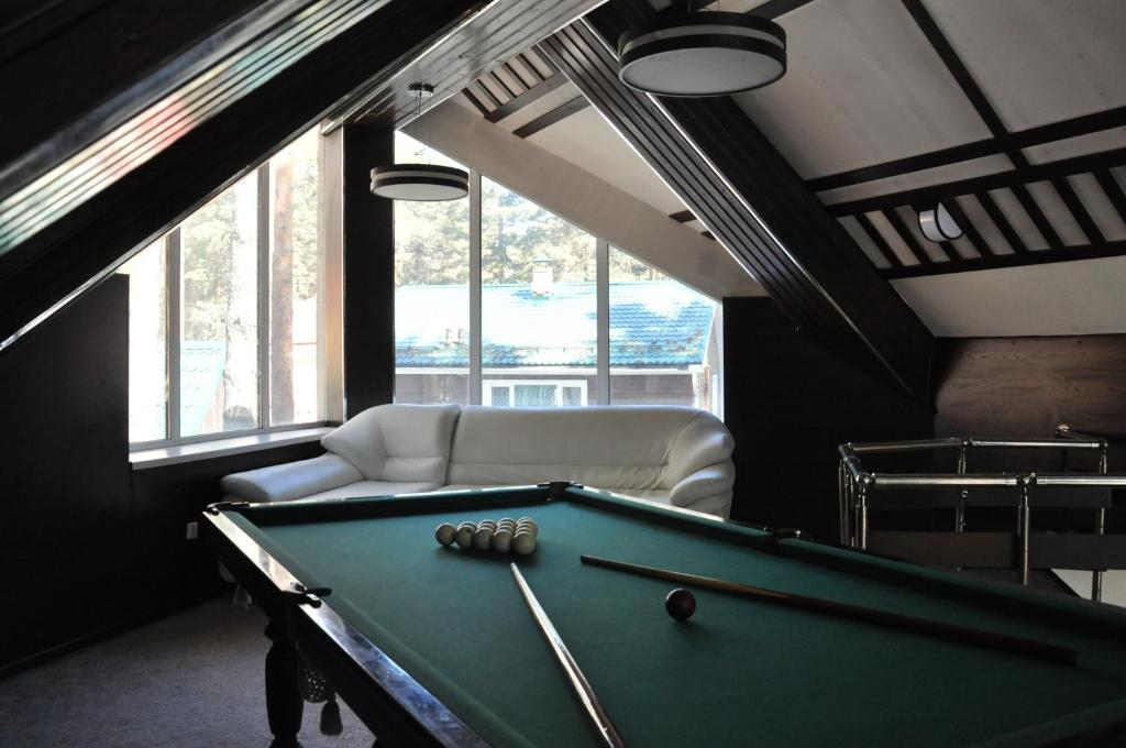 A pool table at Lesnoy Cottage