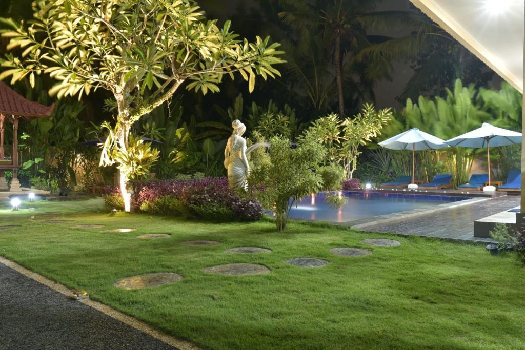 The swimming pool at or near Pondok Yu De Villa Bali