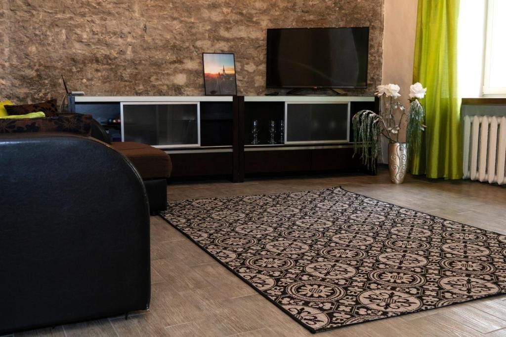 A television and/or entertainment center at Old-Town Storu apartment