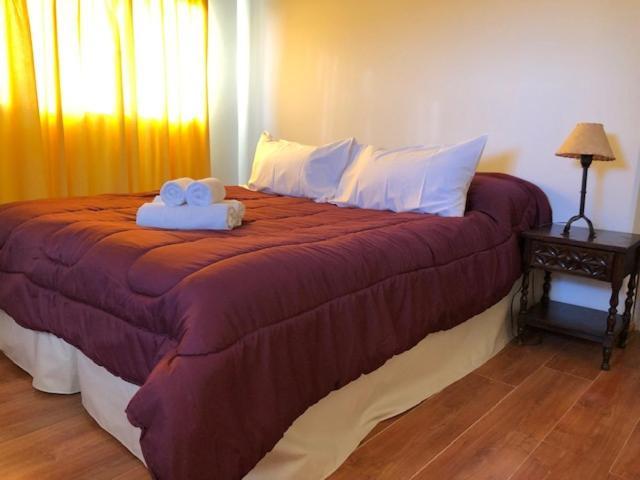 Una cama o camas en una habitación de Bella Vista