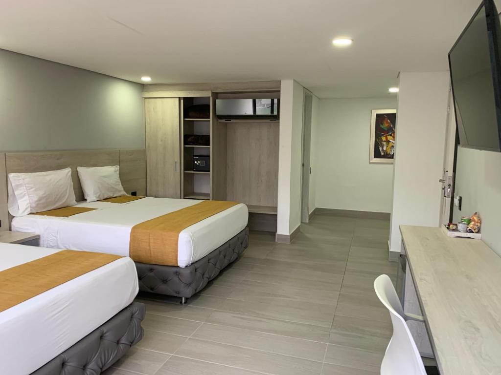 A bed or beds in a room at Hotel Loup