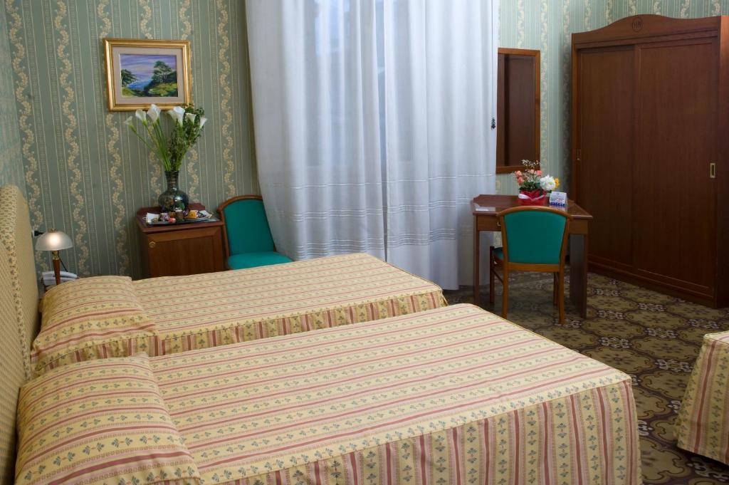 Letto o letti in una camera di Hotel Beatrice