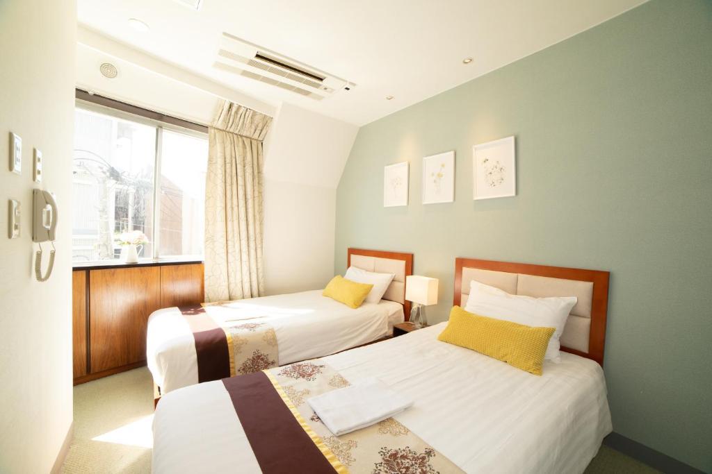 เตียงในห้องที่ Tabata Oji Hotel