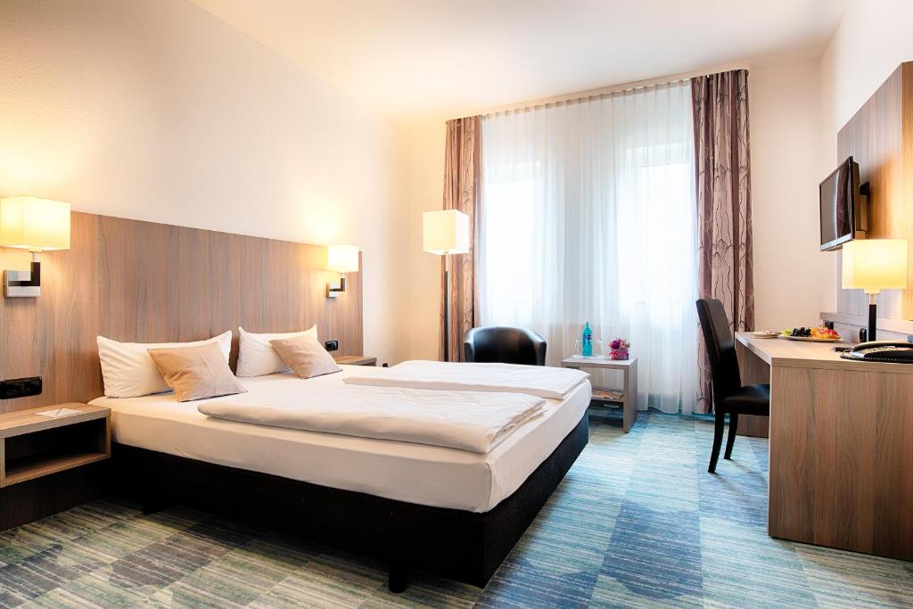 A bed or beds in a room at ACHAT Hotel Bochum Dortmund