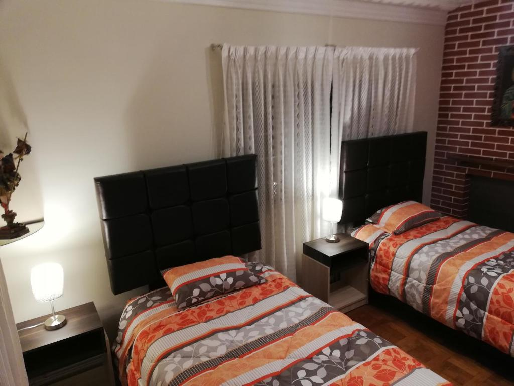A bed or beds in a room at CASA DEPARTAMENTO CUSCO