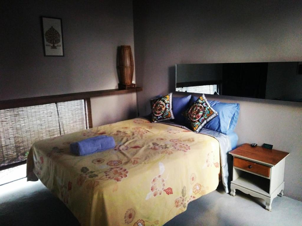 A bed or beds in a room at Baba pim villa