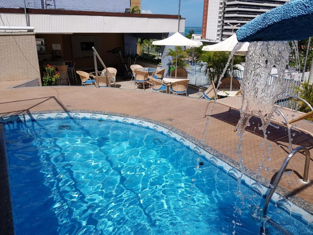 The swimming pool at or near Vila Azul Praia Hotel