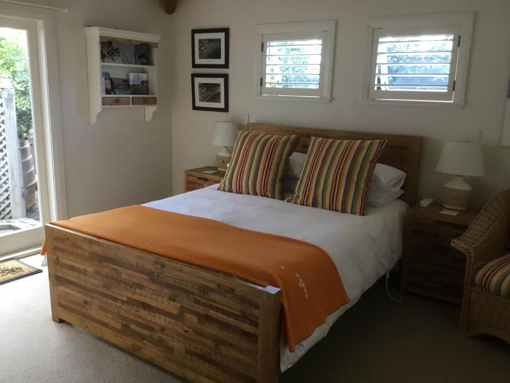 A bed or beds in a room at Manly Beach Bed and Breakfast