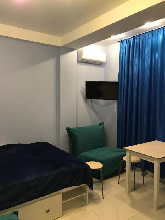 Кровать или кровати в номере Квартира в Олимпийском парке