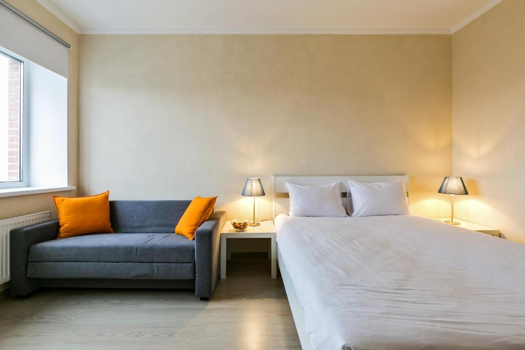 A bed or beds in a room at LASPACE PRIMA Apartments
