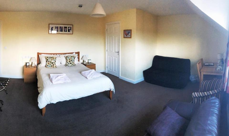 A bed or beds in a room at The Lowfield Inn