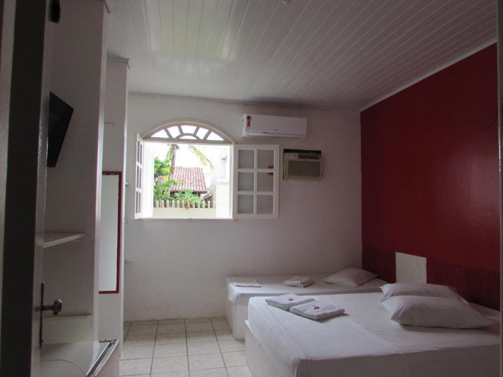 Cama ou camas em um quarto em Pousada Pé de Caju