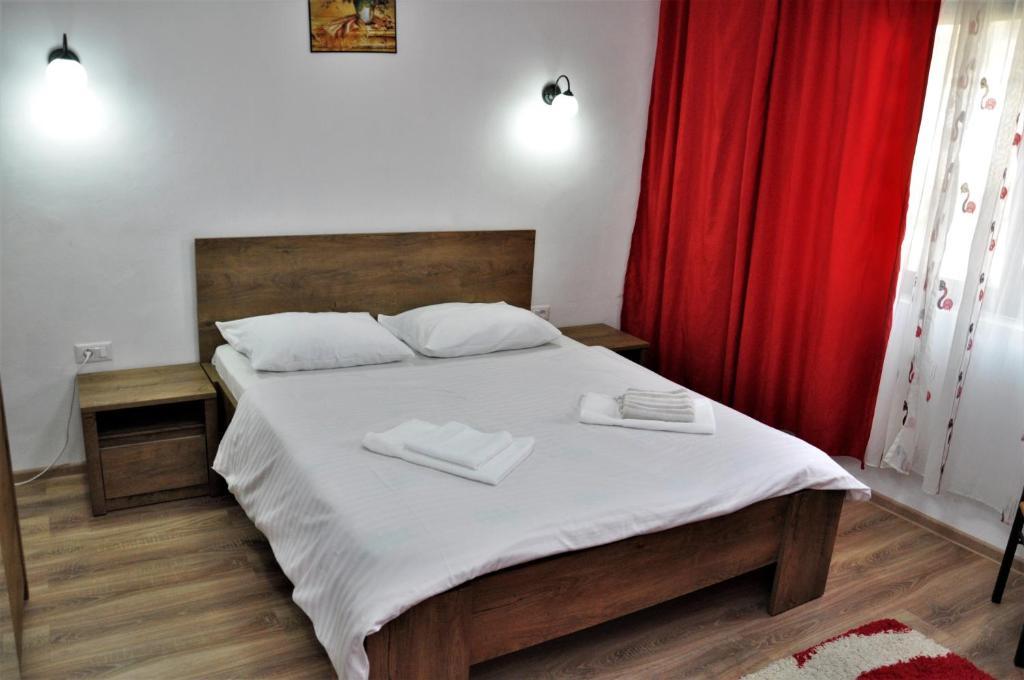 Postel nebo postele na pokoji v ubytování Casa de vacanta Emma
