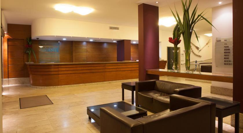 The lobby or reception area at Hotel Regente