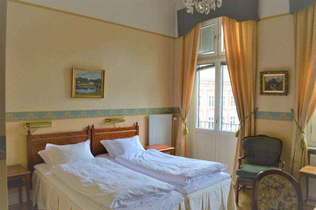 A bed or beds in a room at Hotel Baltzar Jacobsen Sure Hotel Collection by Best Western