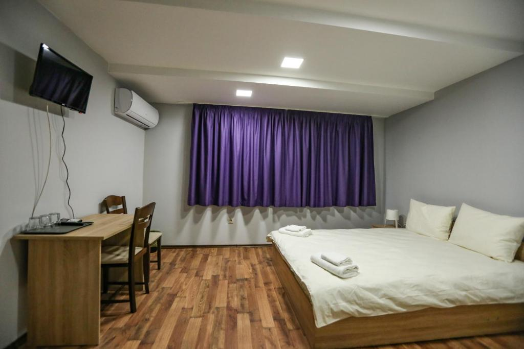 A bed or beds in a room at Centralissimo
