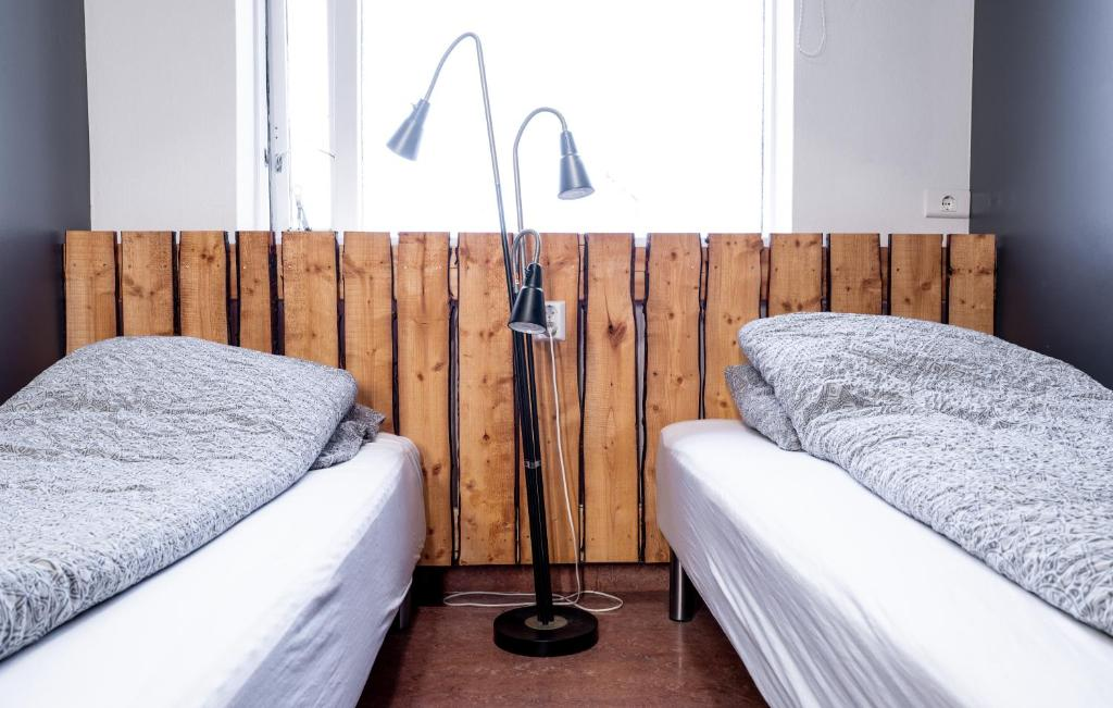 A bed or beds in a room at Au44 hostel