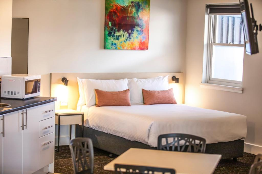 A bed or beds in a room at Nightcap at Glengala Hotel