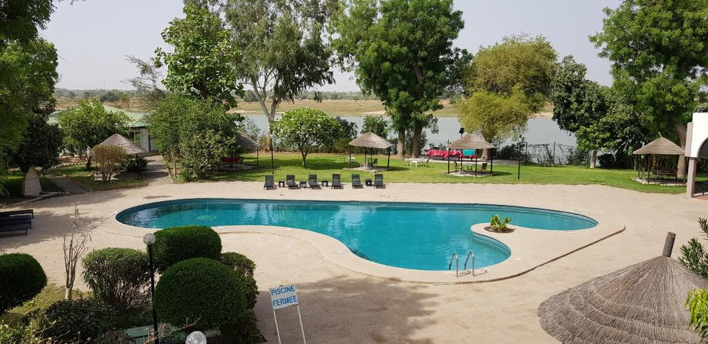 The swimming pool at or near Hotel Le Chari