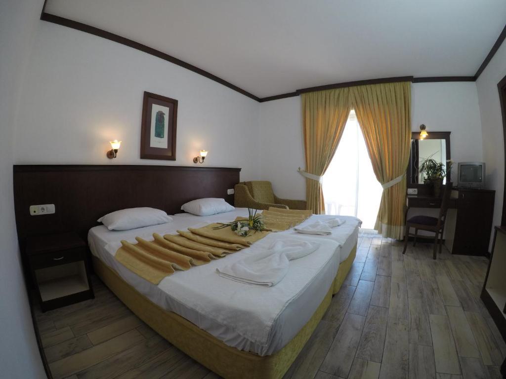 Кровать или кровати в номере Nar Hotel