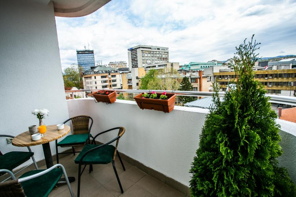 A balcony or terrace at Riverside Apartment
