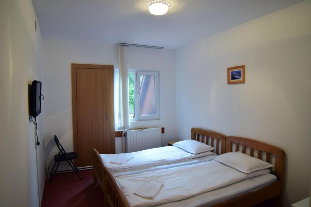 Кровать или кровати в номере Vila Onix