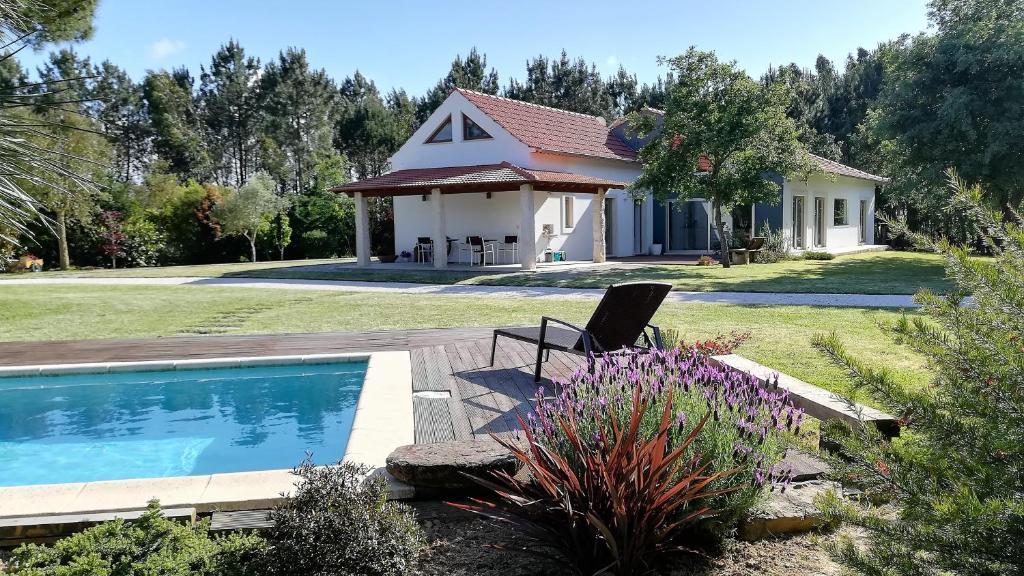 The swimming pool at or near Casa Das Laranjeiras