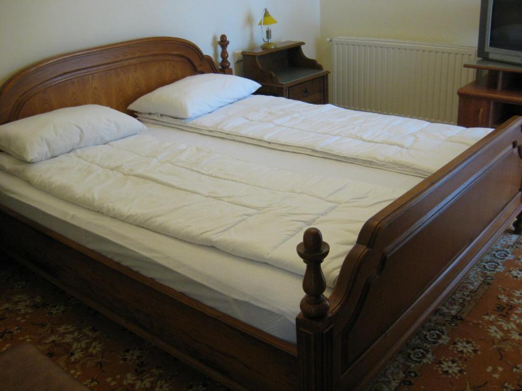 Un pat sau paturi într-o cameră la Vila V3