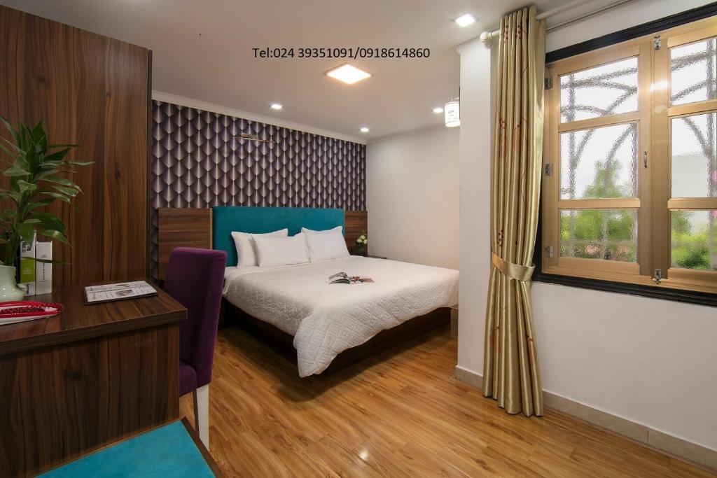 Giường trong phòng chung tại Golden Time Hostel