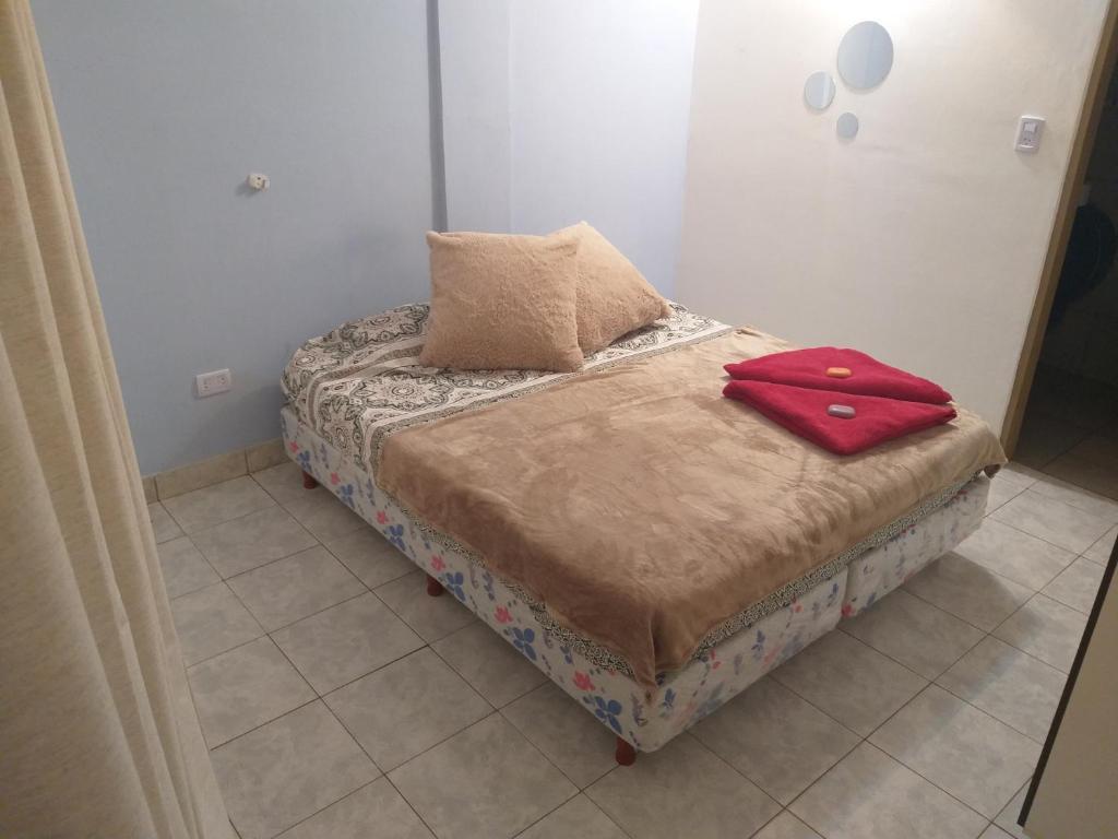 Giường trong phòng chung tại Martín house