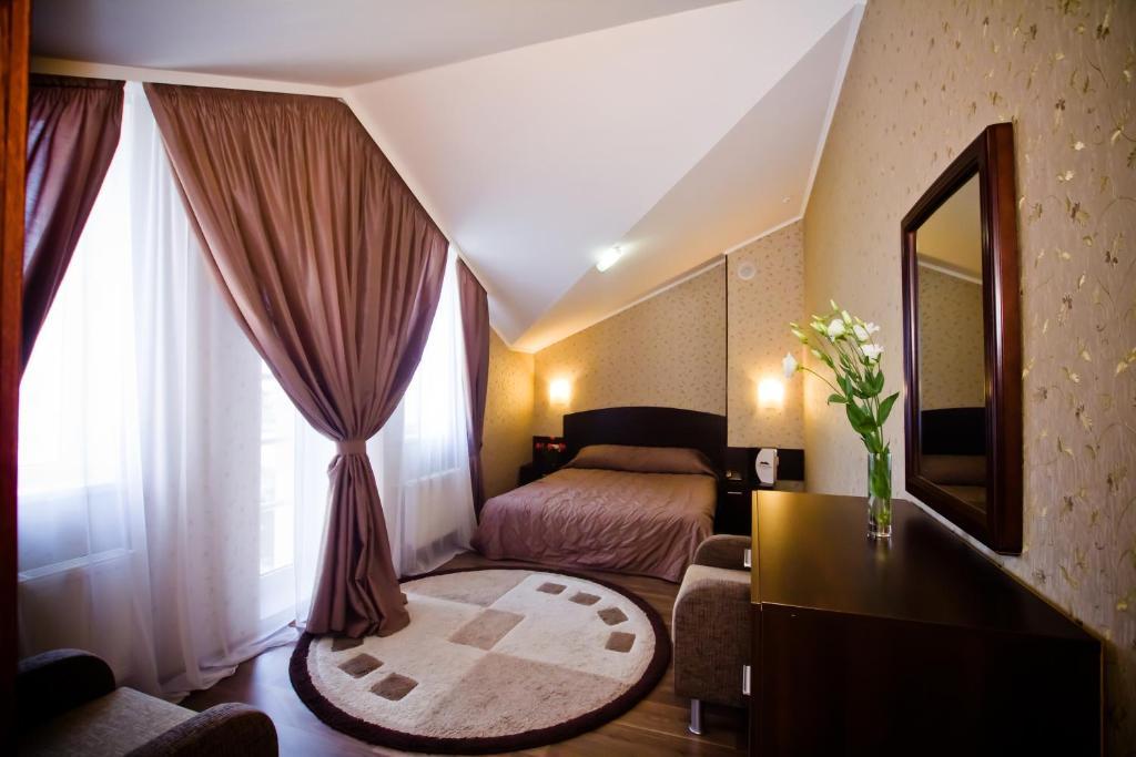 Кровать или кровати в номере City Club Отель