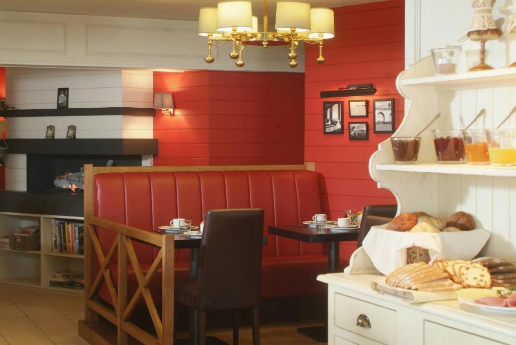 Ein Restaurant oder anderes Speiselokal in der Unterkunft Hotel Internos