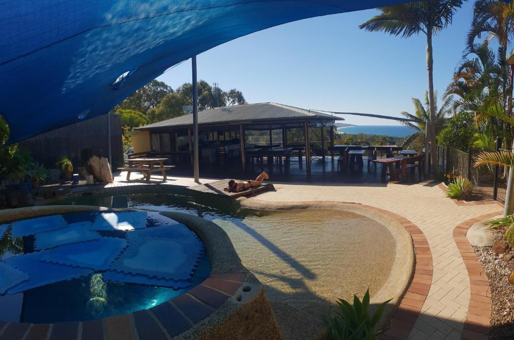 A piscina em ou perto de Escape 1770 (Adults Only)