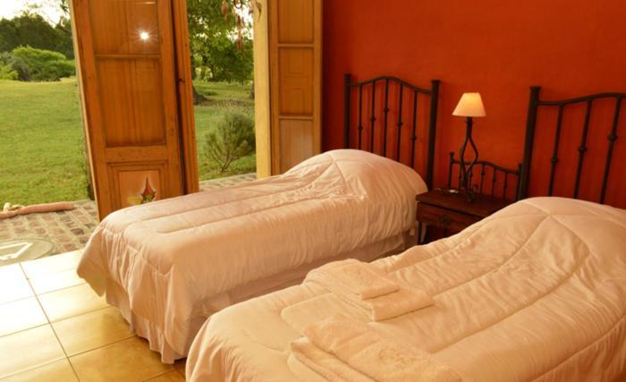 Cama o camas de una habitación en Alquimia Posada